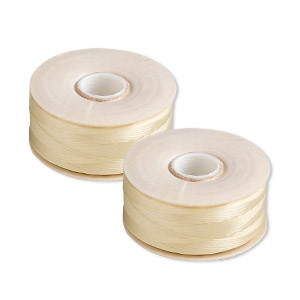 thread, nymo, nylon, light tan, size b. sold per pkg of (2) 72-yard bobbins.